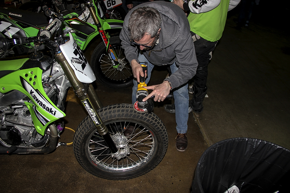 Riders and support team preparing their bikes for the race