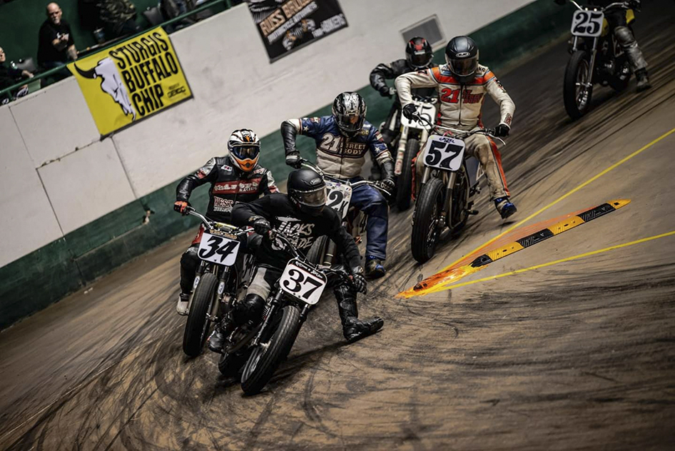 #37 Erik Moldenhauer leading the pack flat track racing during the War of the Twins II in 2019